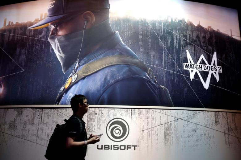 FILE PHOTO: A man walks past the Ubisoft booth at the E3 Electronic Expo in Los Angeles, California, U.S. June 14, 2016. REUTERS/Lucy Nicholson/File Photo
