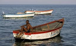 A fisherman prepares his boat on the banks of Lake Malawi about 100 kilometers east of the capital Lilongwe, file. REUTERS/Siphiwe Sibeko