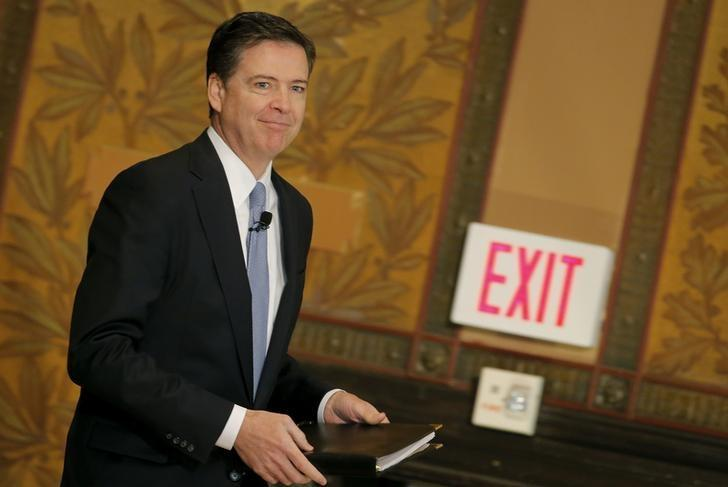 FBI Director James Comey arrives to deliver a speech at the Master of Science in Foreign Service CyberProject's sixth annual conference at Georgetown University in Washington D.C., U.S. April 26, 2016. REUTERS/Carlos Barria/Files