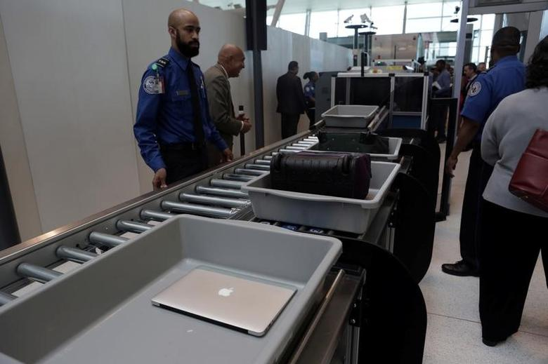 Baggage and a laptop are scanned using the Transport Security Administration's new Automated Screening Lane technology at Terminal 4 of JFK airport in New York City, U.S., May 17, 2017. REUTERS/Joe Penney