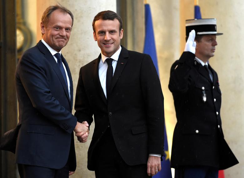 French President Emmanuel Macron welcomes European Council President Donald Tusk (L) upon his arrival at the Elysee Palace in Paris, France, May 17, 2017.    REUTERS/Stephane De Sakutin/Pool