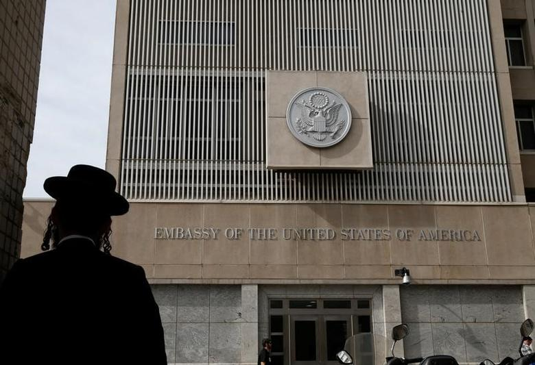 FILE PHOTO: An ultra-Orthodox Jewish man stands in front of the U.S Embassy in Tel Aviv, Israel January 24, 2017. REUTERS/Baz Ratner