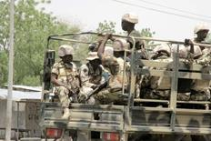 Soldiers are seen on a truck in Maiduguri in Borno State, Nigeria May 14, 2015.   REUTERS/Stringer