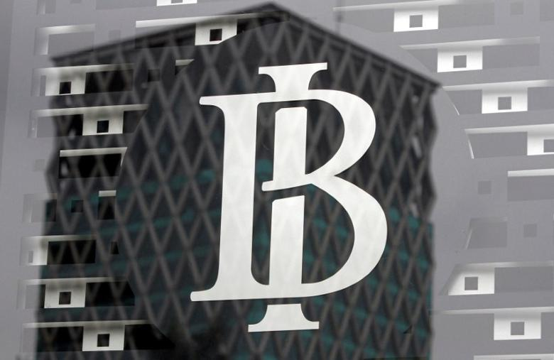 The logo of Indonesia's central bank, Bank Indonesia, is seen on a window in the bank's lobby in Jakarta, Indonesia September 22, 2016. REUTERS/Iqro Rinaldi/File Photo - RTX318ZS