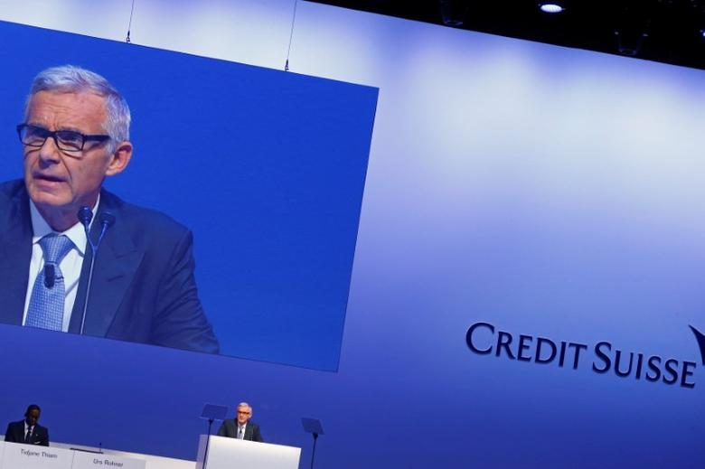 CEO Tidjane Thiam sites beside Chairman Urs Rohner of Swiss bank Credit Suisse as he addresses the audience at the bank's extraordinary shareholder meeting in Zurich, Switzerland May 18, 2017.  REUTERS/Arnd Wiegmann