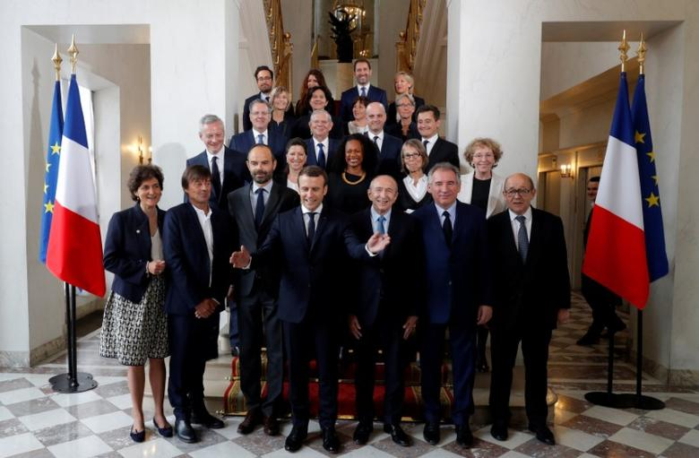 French President Emmanuel Macron (4thL) and Prime Minister Edouard Philippe (3rdL) pose for a family photo after the first cabinet meeting at the Elysee Palace in Paris, France, May 18, 2017.  REUTERS/Philippe Wojazer