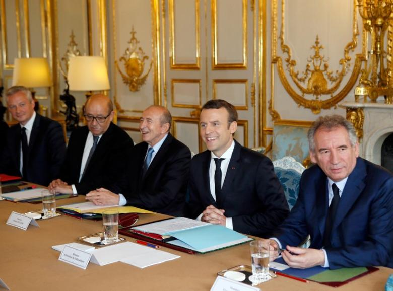 French President Emmanuel Macron (2ndR) attends a cabinet meeting with his newly-named ministers,  Justice minister Francois Bayrou (R), Interior minister Gerard Collomb (C), Foreign and European minister Jean-Yves Le Drian (2ndL) and Economy minister Bruno Le Maire (L) at the Elysee Palace in Paris, France, May 18, 2017.  REUTESR/Francois Mori/Poo
