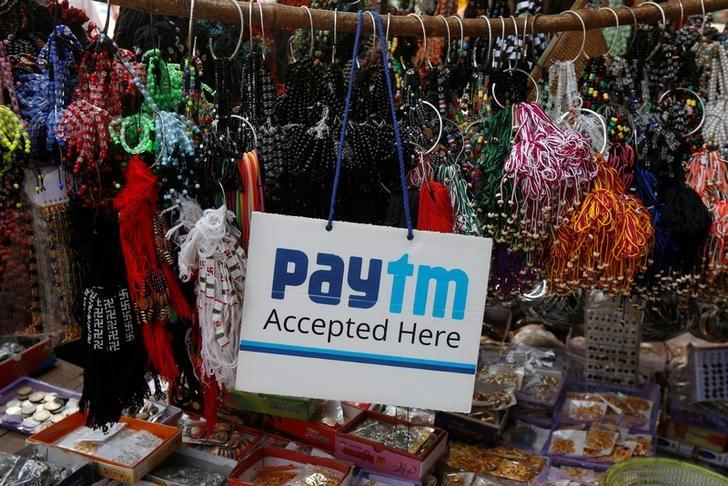 FILE PHOTO: An advertisement of Paytm, a digital wallet company, is pictured at a road side stall in Kolkata, India, January 25, 2017. Picture taken January 25, 2017. REUTERS/Rupak De Chowdhuri