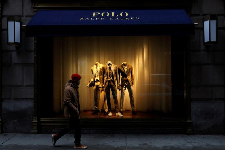 FILE PHOTO: A man walks past Ralph Lauren Corp.'s  flagship Polo store on Fifth Avenue in New York City, U.S., April 4, 2017.    REUTERS/Brendan McDermid/File Photo