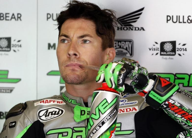 Honda MotoGP rider Nicky Hayden of the U.S. takes a drink in his garage during a free practice session at the Twin Ring Motegi circuit ahead of Sunday's Japanese Grand Prix in Motegi, north of Tokyo October 10, 2014.  REUTERS/Toru Hanai