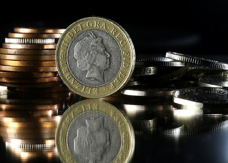 Pound coins are seen in this picture illustration taken January 18, 2017. REUTERS/Dado Ruvic/Illustration