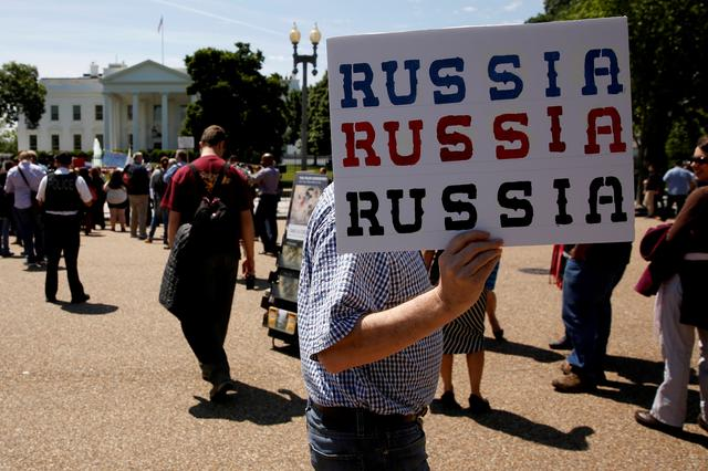 FILE PHOTO - Protesters gather to rally against U.S. President Donald Trump's firing of Federal Bureau of Investigation (FBI) Director James Comey, outside the White House in Washington, U.S. May 10, 2017.  REUTERS/Jonathan Ernst/File Photo