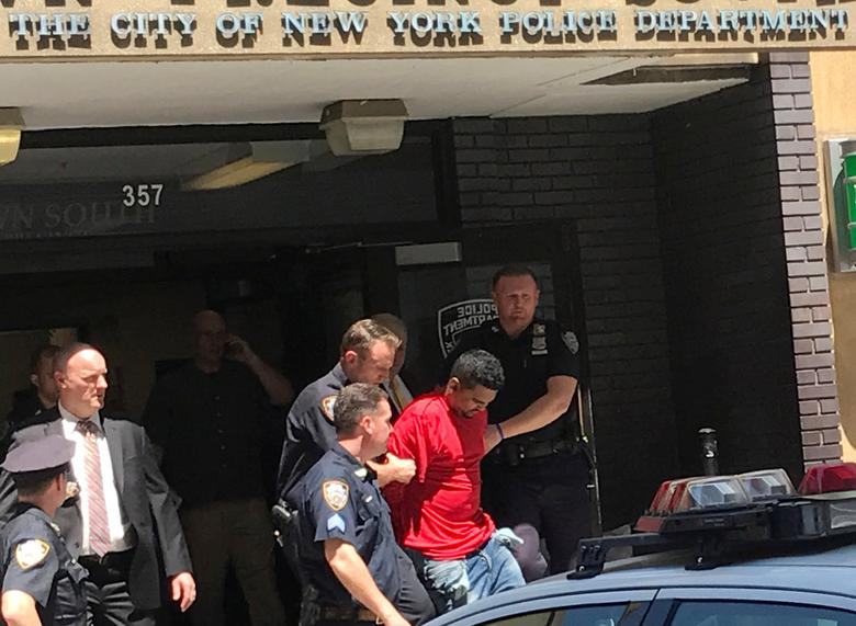 A man who police said was the suspected driver of a car which crashed into a crowd on Times Square, is led out of the NYPD Midtown South precinct in New York, U.S., May 18, 2017. REUTERS/Rodrigo Campos