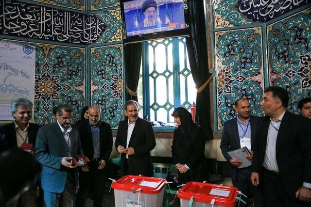 Iranian Vice-President Eshaq Jahangiri and his wife stand after casting their votes during the presidential election in Tehran, Iran, May 19, 2017. TIMA via REUTERS