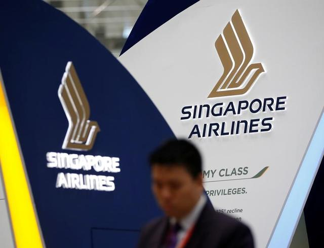 A man walks past a Singapore Airlines signage at Changi Airport in Singapore May 11, 2016. REUTERS/Edgar Su