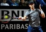 Andy Murray returns the ball . REUTERS/Max Rossi
