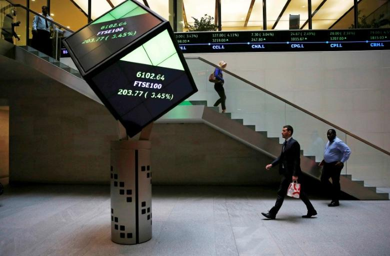 People walk through the lobby of the London Stock Exchange in London, Britain August 25, 2015.  REUTERS/Suzanne Plunkett/File photo