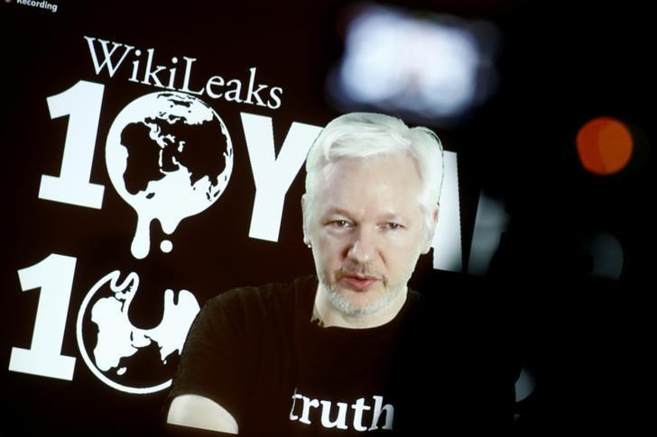 FILE PHOTO: Julian Assange, Founder and Editor-in-Chief of WikiLeaks speaks via video link during a press conference on the occasion of the ten year anniversary celebration of WikiLeaks in Berlin, Germany, October 4, 2016. REUTERS/Axel Schmidt/File Photo