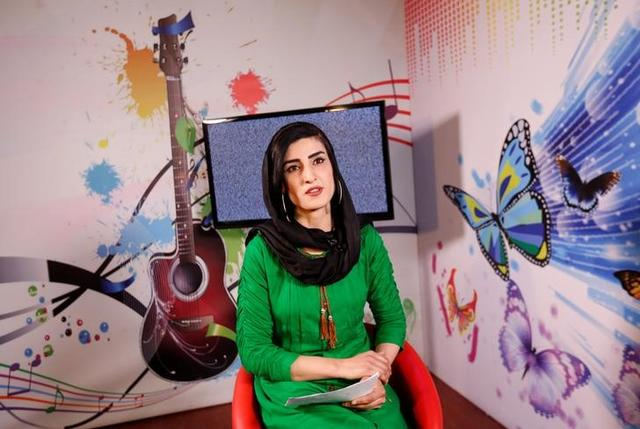 Krishma Naz, 22, presenter of a music show, sits during recording at the Zan TV station (women's TV) in Kabul, Afghanistan May 8, 2017. REUTERS/Mohammad Ismail