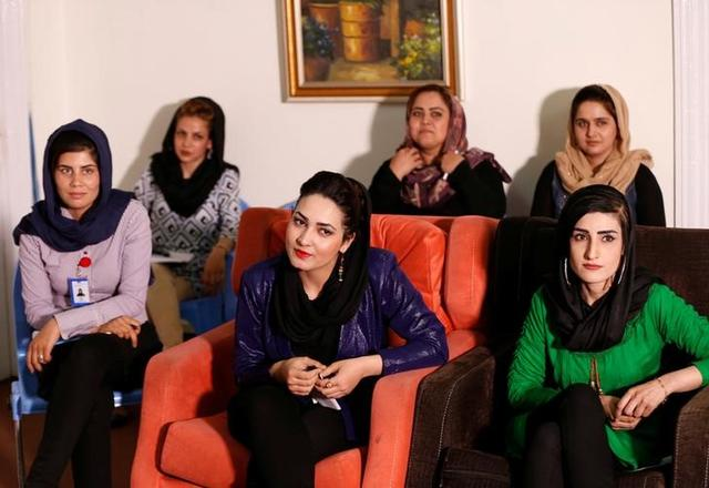 Zan TV station (women's TV) employees attend morning meeting in Kabul, Afghanistan May 8, 2017. REUTERS/Mohammad Ismail