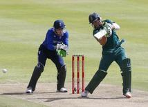 South Africa's AB de Villiers (R) plays a shot as England's Jos Buttler looks on during the One Day International Cricket match in Cape Town, South Africa, February 14, 2016. REUTERS/Mike Hutchings
