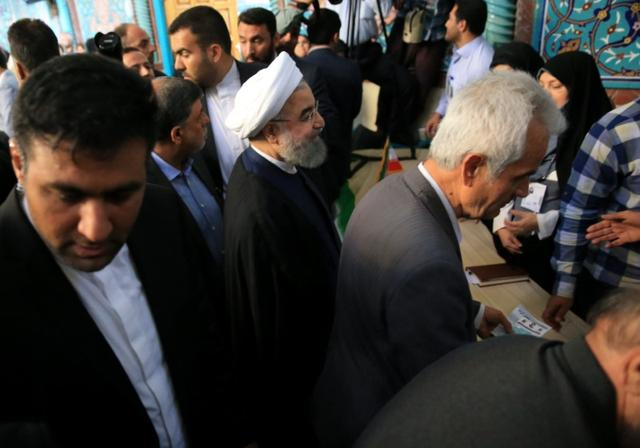 Iranian President Hassan Rouhani arrives to cast his vote during the presidential election in Tehran, Iran, May 19, 2017. TIMA via REUTERS