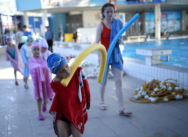 Ismail Zulfic, 6-year old armless swimmer leaves after training in Olympic Pool Otoka in Sarajevo, May 18, 2017. Picture taken May 18, 2017. REUTERS/Dado Ruvic