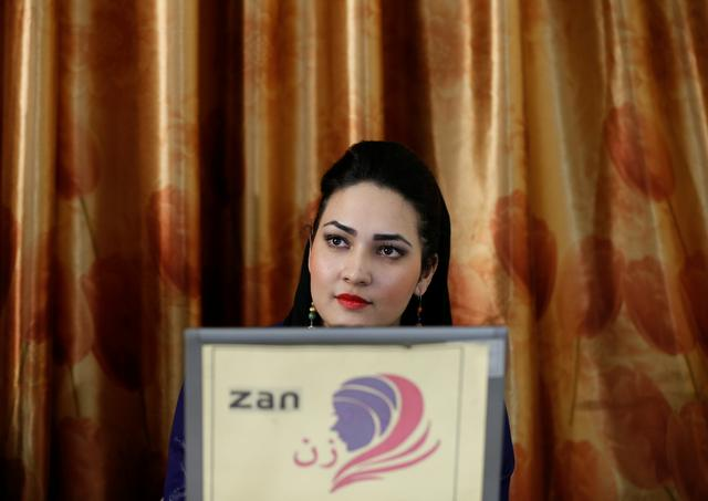 Rozena Khatebi, news director of the Zan TV station (women's TV) works on her computer in Kabul, Afghanistan May 8, 2017. REUTERS/Mohammad Ismail