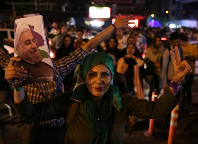 Supporters of Iranian president Hassan Rouhani celebrate his victory in the presidential election in Tehran, Iran, May 20, 2017. TIMA via REUTERS