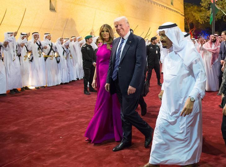 U.S. President Donald Trump and first lady Melania Trump are welcomed by Saudi Arabia's King Salman bin Abdulaziz Al Saud at Al Murabba Palace in Riyadh, Saudi Arabia May 20, 2017. Picture taken May 20, 2017. Bandar Algaloud/Courtesy of Saudi Royal Court/Handout via REUTERS