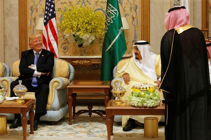U.S. President Donald Trump (L) waits for the start of an event with Saudi Arabia's King Salman bin Abdulaziz Al Saud (2-R) and Gulf Cooperation Council leaders at their summit in Riyadh, Saudi Arabia May 21, 2017. REUTERS/Jonathan Ernst