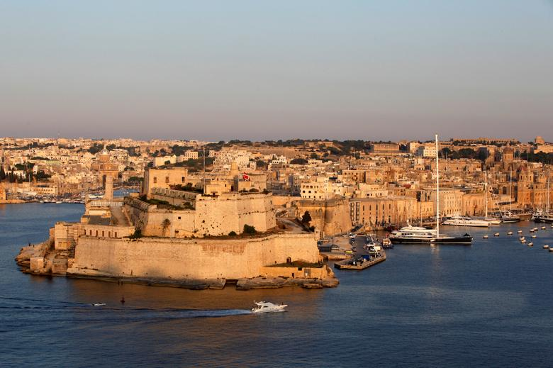 FILE PHOTO: A boat sails past the medieval Fort Saint Angelo in Vittoriosa, in Valletta's Grand Harbour, Malta June 17, 2012. REUTERS/Darrin Zammit Lupi/File Photo.