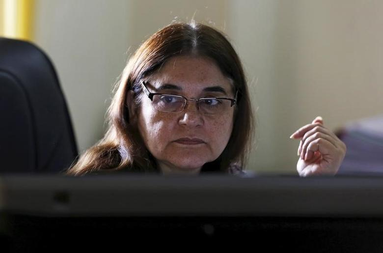 India's Women and Child Welfare minister Maneka Gandhi, works on a computer before an interview with Reuters at her office in New Delhi, October 19, 2015. REUTERS/Adnan Abidi/Files