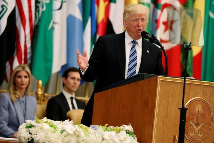 U.S. President Donald Trump, flanked by Ivanka Trump and White House senior advisor Jared Kushner, delivers remarks to the Arab Islamic American Summit in Riyadh, Saudi Arabia May 21, 2017.  REUTERS/Jonathan Ernst