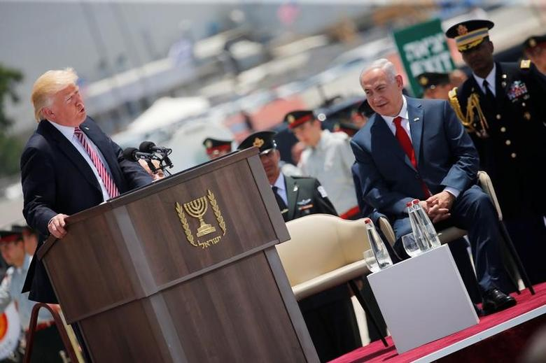 Israel's Prime Minister Benjamin Netanyahu (R) listens as U.S. President Donald Trump (L) speaks during a welcoming ceremony upon his arrival at Ben Gurion International Airport in Lod near Tel Aviv, Israel May 22, 2017. REUTERS/Jonathan Ernst