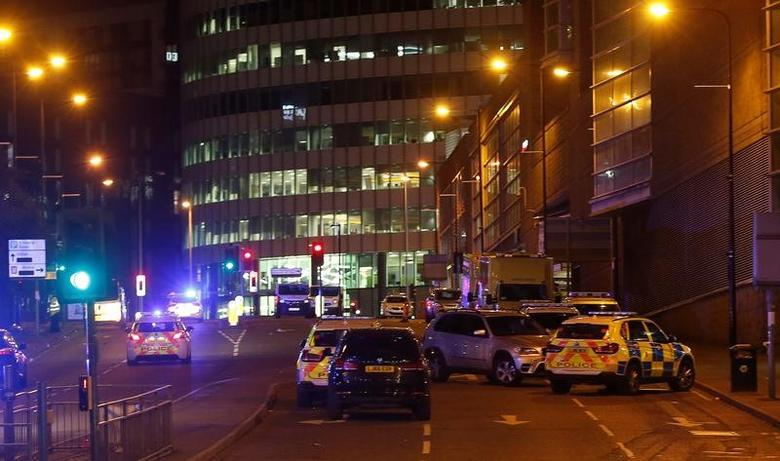 Vehicles are seen near a police cordon outside the Manchester Arena, where U.S. singer Ariana Grande had been performing, in Manchester, northern England, Britain, May 23, 2017. REUTERS/Andrew Yates