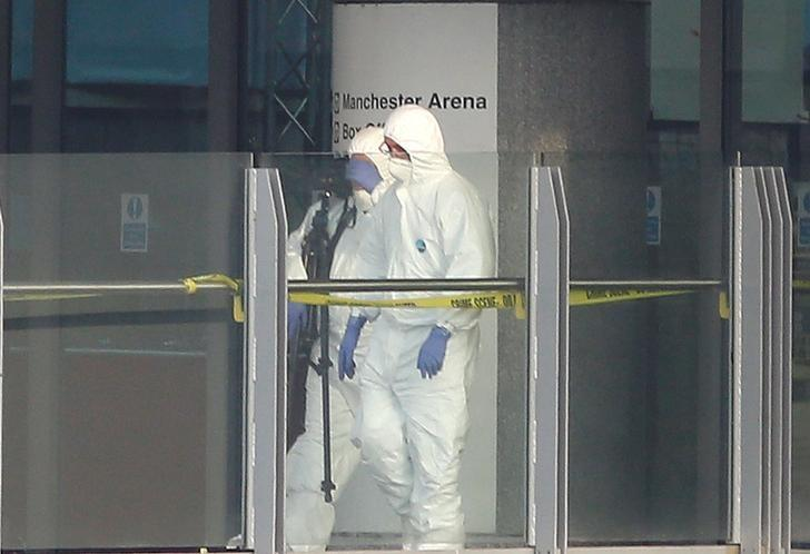 Forensics investigators work at the entrance of the Manchester Arena, Britain May 23, 2017. REUTERS/Andrew Yates