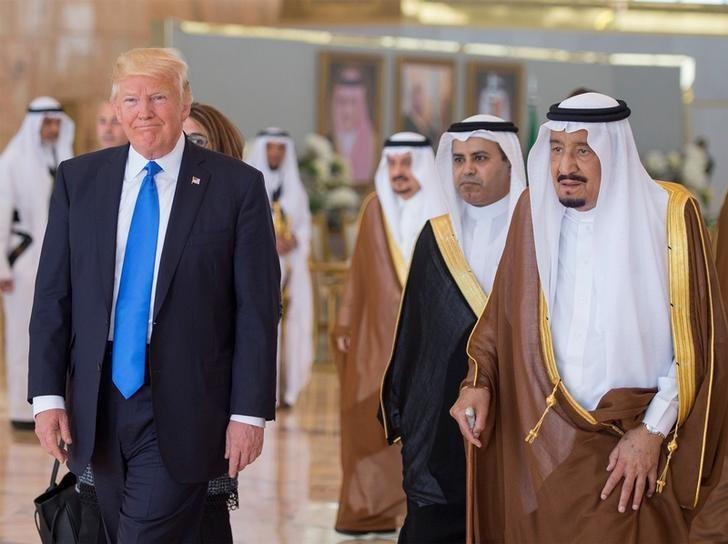 Saudi Arabia's King Salman bin Abdulaziz Al Saud walks with U.S. President Donald Trump during a reception ceremony in Riyadh, Saudi Arabia, May 20, 2017.Bandar Algaloud/Courtesy of Saudi Royal Court/Handout via REUTERS