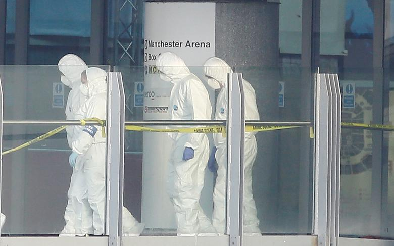 Forensics investigators work at the entrance of the Manchester Arena. REUTERS/Andrew Yates