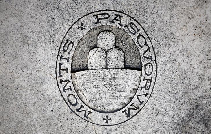 FILE PHOTO: A logo of Monte dei Paschi di Siena bank is seen on the ground in Siena, Italy, November 5, 2014. REUTERS/Giampiero Sposito/File Photo