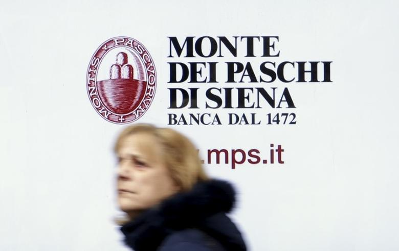 A woman walks in front of the Monte dei Paschi bank in Siena, central Italy, January 29, 2016. REUTERS/Max Rossi