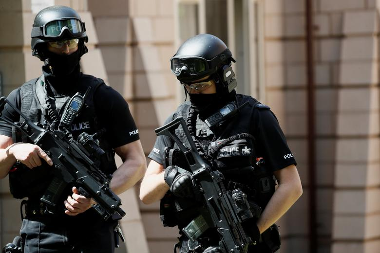 Armed police officers stand outside a residential property near to where a man was arrested in the Chorlton area of Manchester, Britain May 23, 2017. REUTERS/Stefan Wermuth