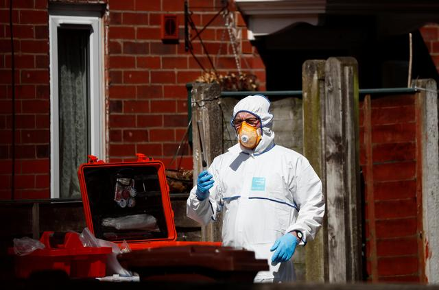 Police investigators work at residential property in south Manchester, Britain May 23, 2017. REUTERS/Stefan Wermuth