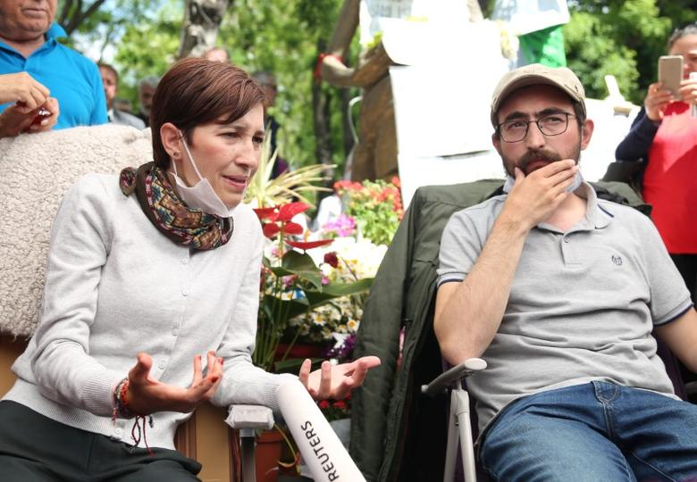 FILE PHOTO: Nuriye Gulmen, a literature professor, and Semih Ozakca, a primary school teacher, who have been on hunger strike after they both lost their jobs in a crackdown following a failed July coup against President Tayyip Erdogan, take part in a protest against a government purge in Ankara, Turkey, May 11, 2017. REUTERS/Alp Eren Kaya