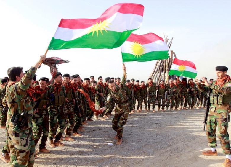 FILE PHOTO: Kurdish Peshmerga forces celebrate Newroz Day, a festival marking spring and the new year, in Kirkuk March 20, 2017. REUTERS/Ako Rasheed/File Photo