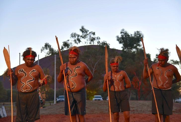 Local performers dance during the opening ceremony for the National Indigenous Constitutional Convention, a three day conference designed to come up with a consensus response on how indigenous people should be recognised in Australia's constitution, at Mutitjulu near Uluru in central Australia, May 23, 2017. AAP/Lucy Hughes Jones/via REUTERS