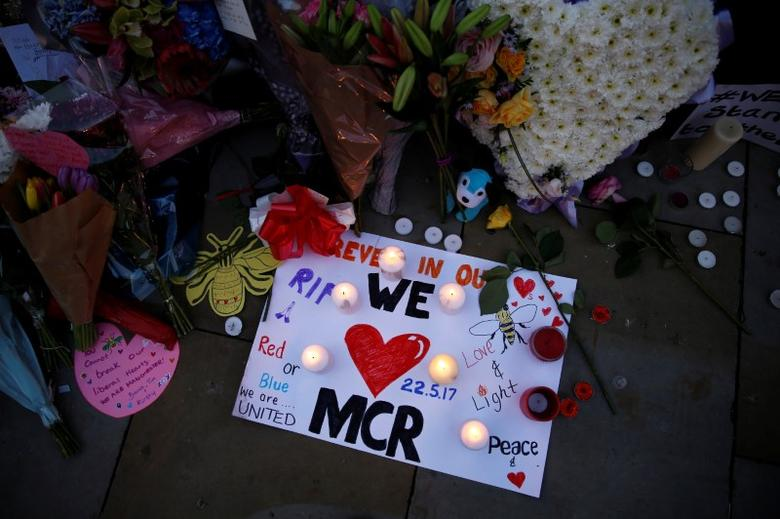 Flowers and messages are left for the victims of the Manchester Arena attack in central Manchester, Britain May 23, 2017. REUTERS/Stefan Wermuth