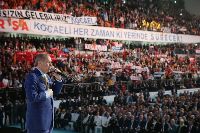 Turkish President Tayyip Erdogan makes a speech during the Extraordinary Congress of the ruling AK Party (AKP) in Ankara, Turkey May 21, 2017. Yasin/Bulbul/Presidential Palace/Handout via REUTERS