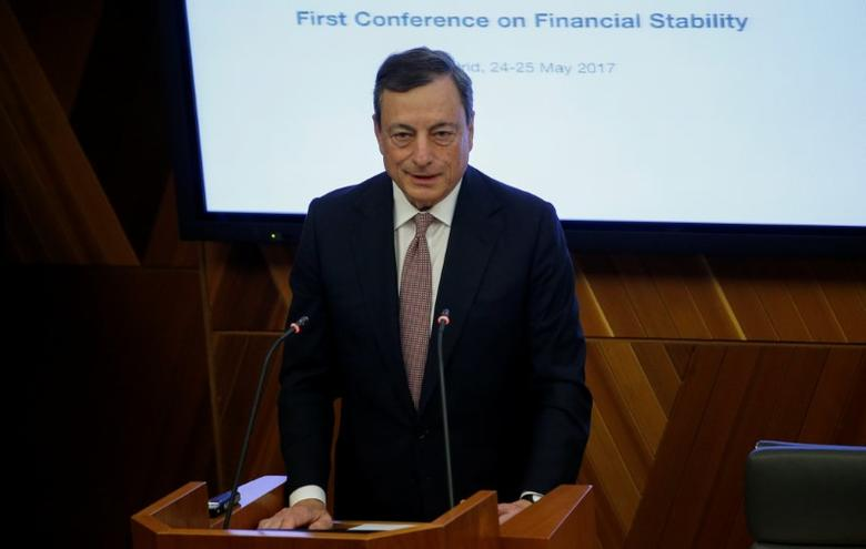 European Central Bank (ECB) President Mario Draghi delivers his speech during an event at Bank of Spain headquarters in Madrid, Spain May 24, 2017. REUTERS/Juan Medina