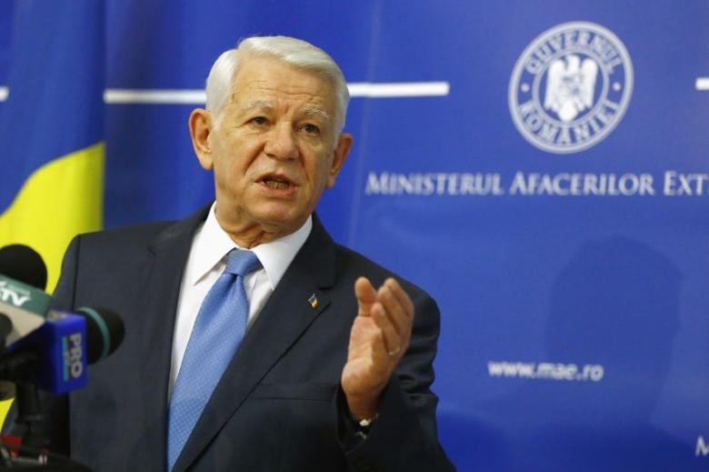 Romania's Foreign Minister Teodor Melescanu gestures during a news conference announcing his resignation in Bucharest November 18, 2014. REUTERS/Bogdan Cristel